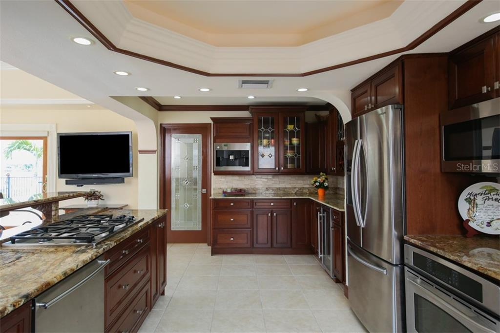 Truly A Gourmet Chefs Delight With Wood Cabinets, Granite Counters And  Stainless Steel Appliances
