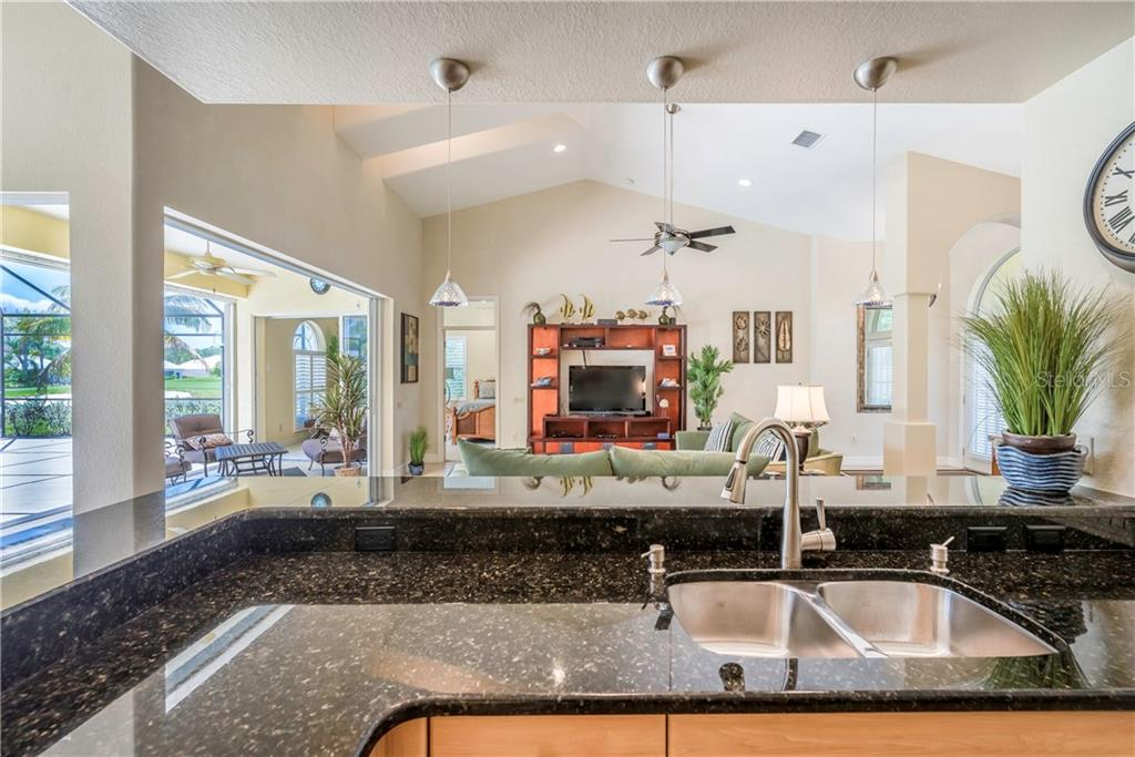 Family or entertaining, no one is left out while you're cooking! - Single Family Home for sale at 931 Linkside Way, Punta Gorda, FL 33955 - MLS Number is C7400849