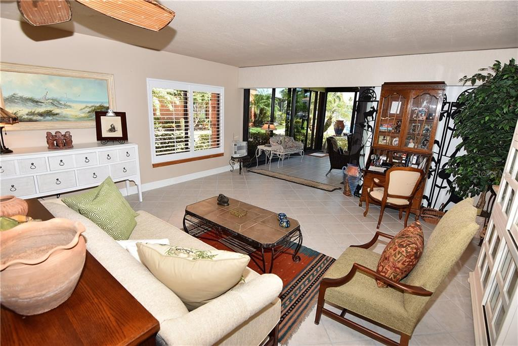 Living room into the lanai - Condo for sale at 3210 Southshore Dr #11a, Punta Gorda, FL 33955 - MLS Number is C7402449
