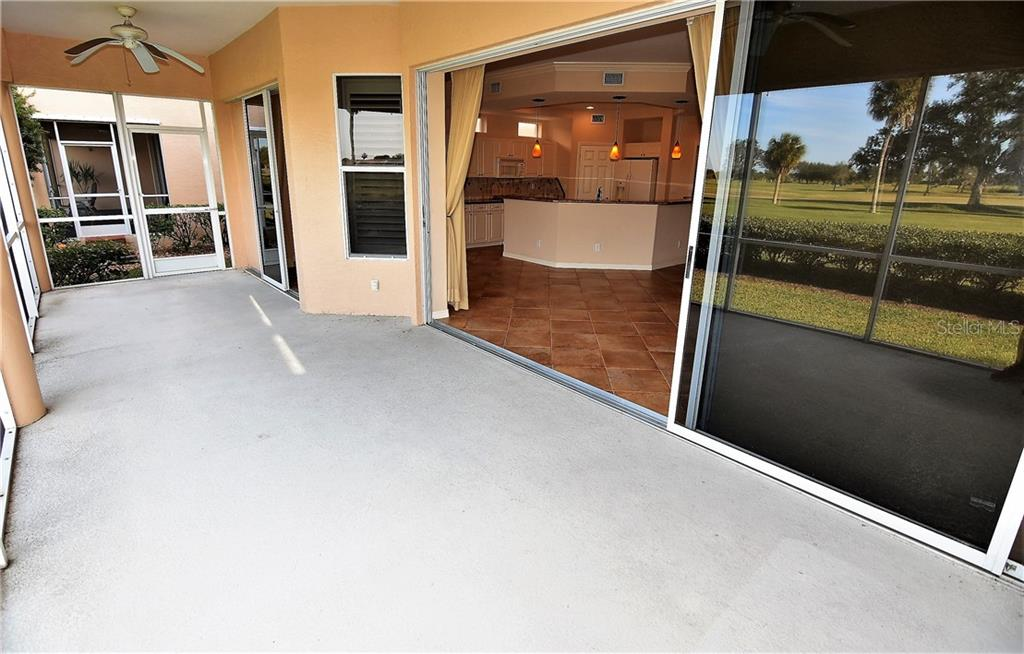 Large covered/screened lanai with access from dining area and living area. - Condo for sale at 3959 San Rocco Dr #212, Punta Gorda, FL 33950 - MLS Number is C7409637