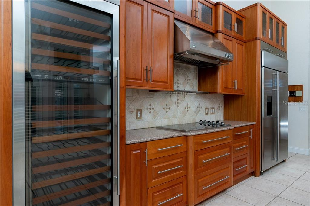 Sub Zero Wine Refrigerator, Viking Professional 6 burner induction cook top, GE Monogram Hood and side by side Refrigerator. - Single Family Home for sale at 1309 Casey Key Dr, Punta Gorda, FL 33950 - MLS Number is C7413790