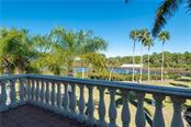 VIEW FROM LOFT OVERLOOKING THE WATER - Single Family Home for sale at 13000 Windcrest Dr, Port Charlotte, FL 33953 - MLS Number is C7410459
