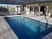 Imagine jumping into your pool on those hot, sunny days! - Single Family Home for sale at 24 Tiffany St, Englewood, FL 34223 - MLS Number is C7410842