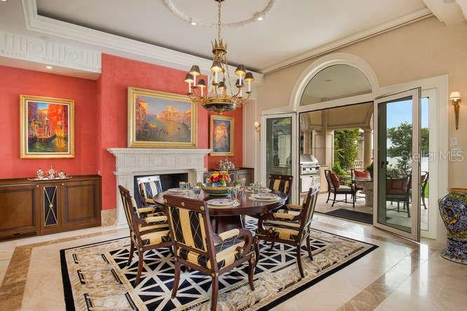 Dining Room looking towards Alfresco Dining on Pool Loggia - Single Family Home for sale at 1492 Casey Key Rd, Nokomis, FL 34275 - MLS Number is A4189751