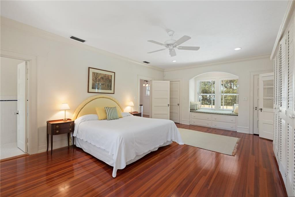 Extra large master bedroom with window seat to the private yard and bay views, abundant storage and large master bath, private sitting room/office with balcony attached to master bedroom - Single Family Home for sale at 3221 Bay Shore Rd, Sarasota, FL 34234 - MLS Number is A4200323
