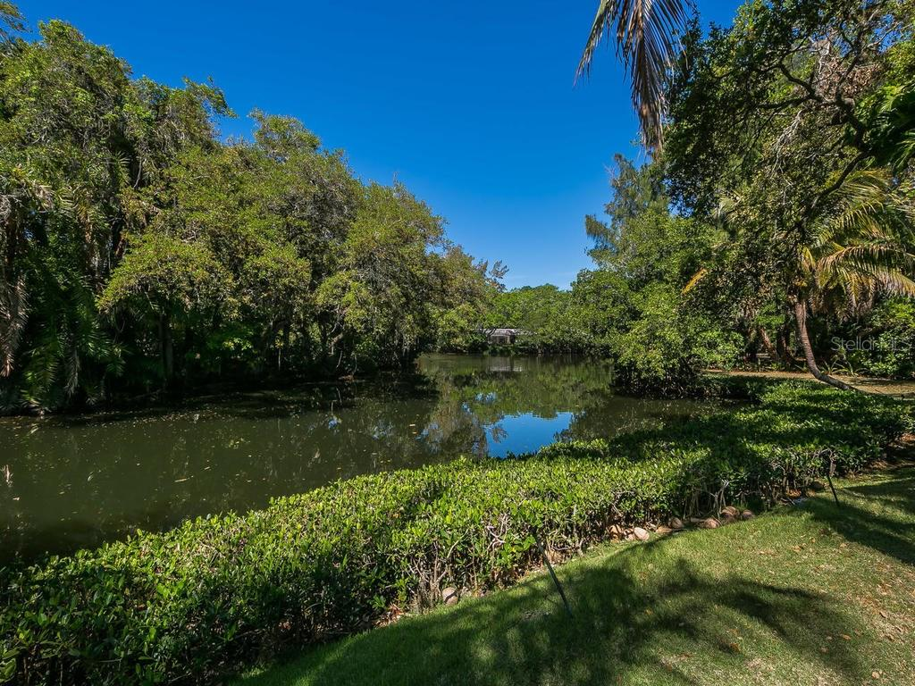 View of scenic waterway from yard - Single Family Home for sale at 7340 Pine Needle Rd, Sarasota, FL 34242 - MLS Number is A4200855
