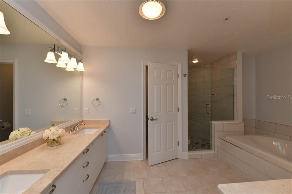 Spacious master bath with double sinks, walk-in shower and soaking tub for leisure time! - Single Family Home for sale at 3947 Somerset Dr, Sarasota, FL 34242 - MLS Number is A4201541