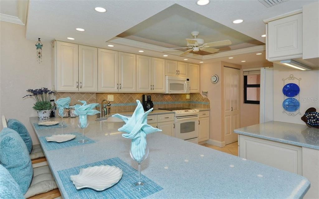 Kitchen with breakfast counter - Condo for sale at 6480 Midnight Pass Rd #217, Sarasota, FL 34242 - MLS Number is A4202790