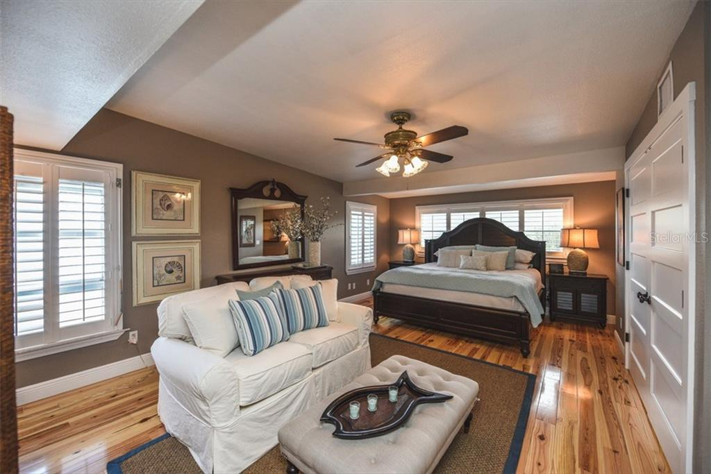 Master suite with gleaming heart pine floors. - Single Family Home for sale at 306 Gulf Blvd, Anna Maria, FL 34216 - MLS Number is A4206962