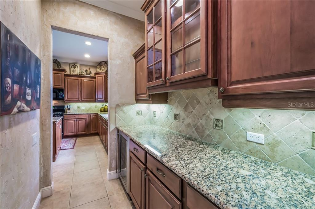 Butler S Pantry Wine Bar Area Granite Countertops Wood Cabinetry And Tumble Stone