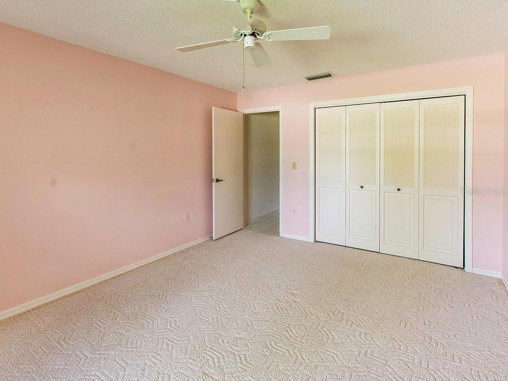 2nd bedroom with large wall to wall closet - Villa for sale at 7467 Carnoustie Dr #5d, Sarasota, FL 34238 - MLS Number is A4412518