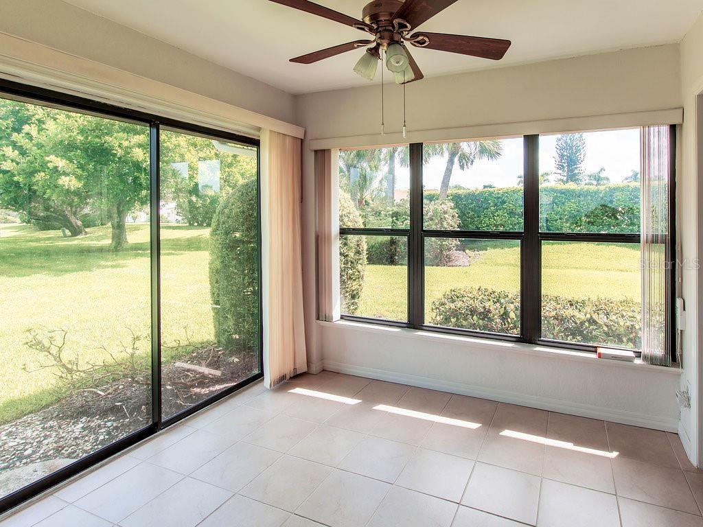Slider and window in this enclosed lanai provide a lot of natural light and additional livable space - Villa for sale at 7467 Carnoustie Dr #5d, Sarasota, FL 34238 - MLS Number is A4412518