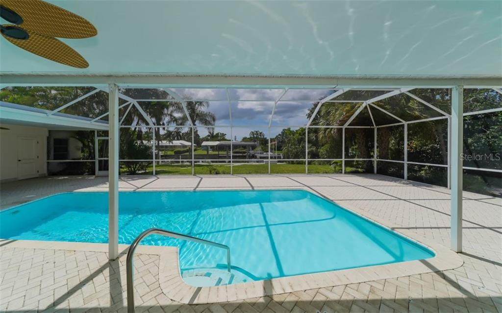 Plenty of room in the pool! And not a bad view either! - Single Family Home for sale at 390 Bob White Dr, Sarasota, FL 34236 - MLS Number is A4413388