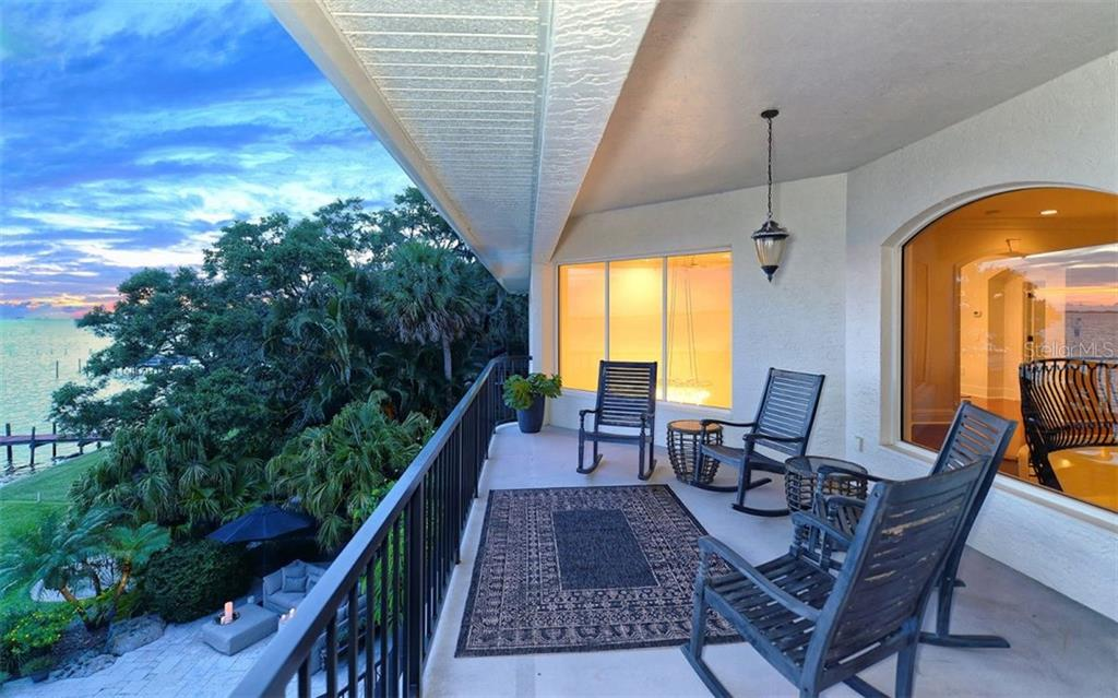 Private balcony off of master suite overlooking Sarasota Bay. - Single Family Home for sale at 2145 Alameda Ave, Sarasota, FL 34234 - MLS Number is A4414337