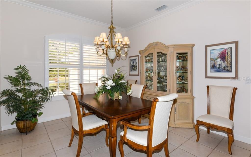Large dining room - Single Family Home for sale at 8473 Eagle Preserve Way, Sarasota, FL 34241 - MLS Number is A4425945