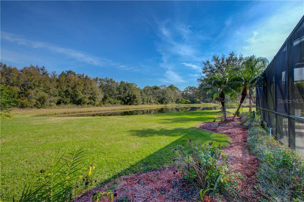 As you can see, the view of the backyard and lake is private, spacious, and absolutely wonderful! - Single Family Home for sale at 15109 17th Ave E, Bradenton, FL 34212 - MLS Number is A4425963