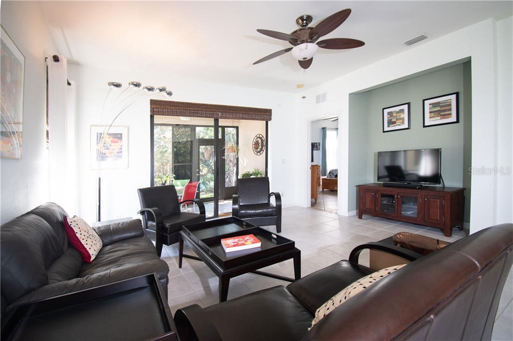 Living Room with view to the lanai and the Master Bedroom - Villa for sale at 1808 Batello Dr, Venice, FL 34292 - MLS Number is A4426491