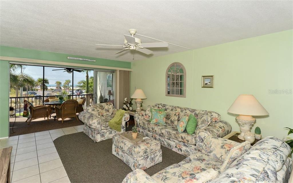 Open and Spacious Living area. - Condo for sale at 797 Beach Rd #215, Sarasota, FL 34242 - MLS Number is A4430524