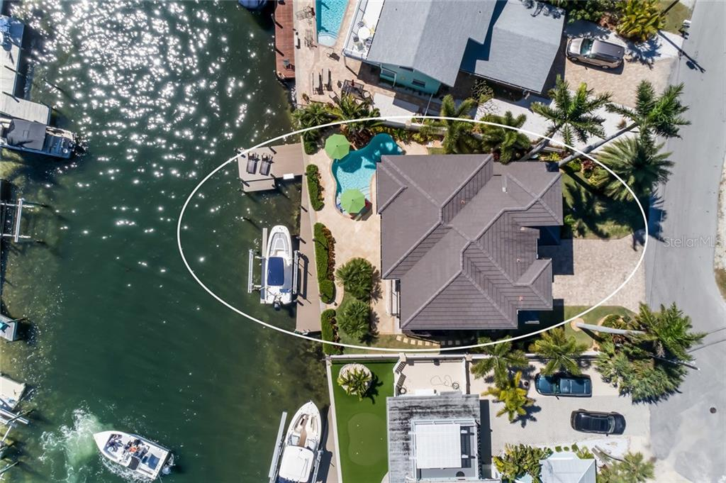 Single Family Home for sale at 221 N Harbor Dr, Holmes Beach, FL 34217 - MLS Number is A4430591
