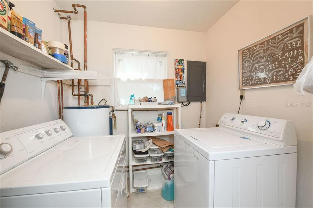 First floor laundry room. - Single Family Home for sale at 7727 Westmoreland Dr, Sarasota, FL 34243 - MLS Number is A4430900