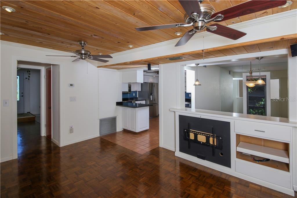 Family room w/tongue and groove cypress ceiling, ceiling fans, parquet floor & built ins & Bose surround sound - Single Family Home for sale at 7611 Alhambra Dr, Bradenton, FL 34209 - MLS Number is A4434753