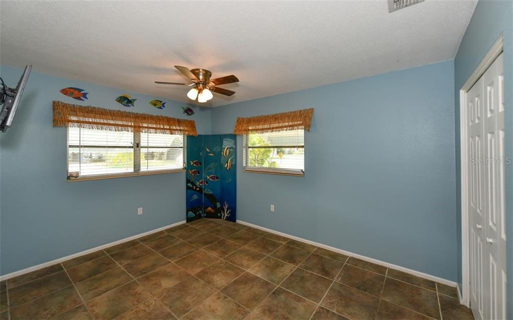 Bedroom 2 - Single Family Home for sale at 120 23rd Street Ct Ne, Bradenton, FL 34208 - MLS Number is A4438232