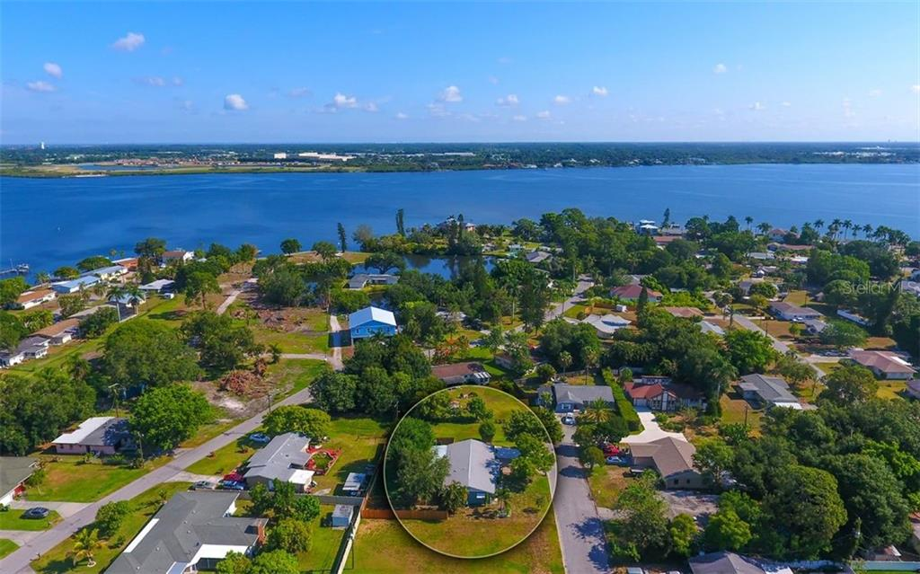 Aerial showing proximity to Manatee River. - Single Family Home for sale at 120 23rd Street Ct Ne, Bradenton, FL 34208 - MLS Number is A4438232
