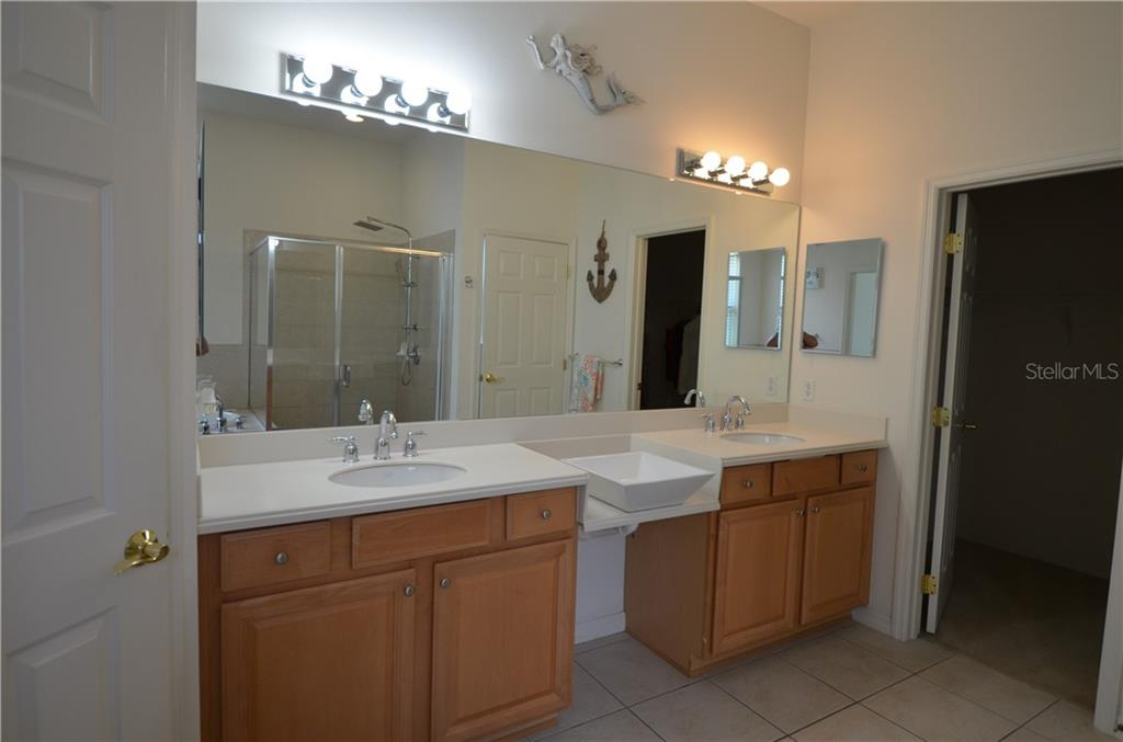 Master bathroom has double vanities, lots of cabinets, tile floors, master closet is huge. - Single Family Home for sale at 3632 Summerwind Cir, Bradenton, FL 34209 - MLS Number is A4438762