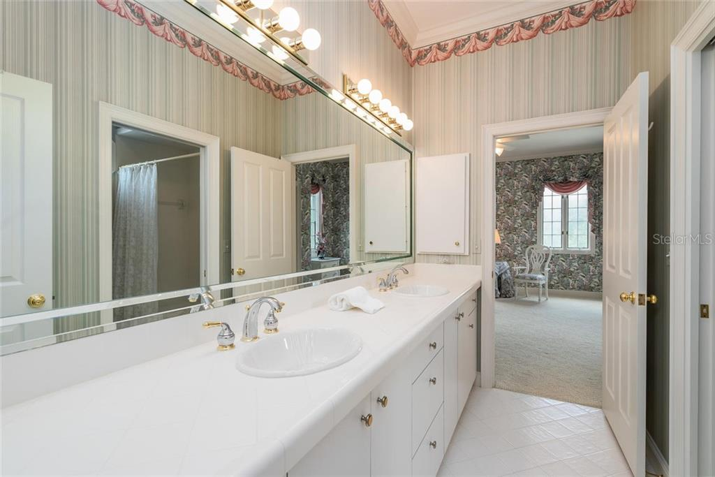 Jack 'n Jill Guest Bathroom - accessible from Guest bedrooms #4 & #5 with privacy pocket door to W/C and shower. - Single Family Home for sale at 3702 Beneva Oaks Blvd, Sarasota, FL 34238 - MLS Number is A4438878