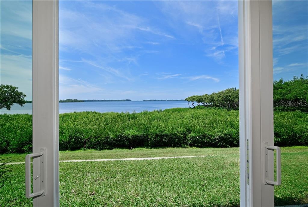 View back through the entertaining area with mirror reflecting the marvelous view .. - Condo for sale at 4706 Independence Dr, Bradenton, FL 34210 - MLS Number is A4443759