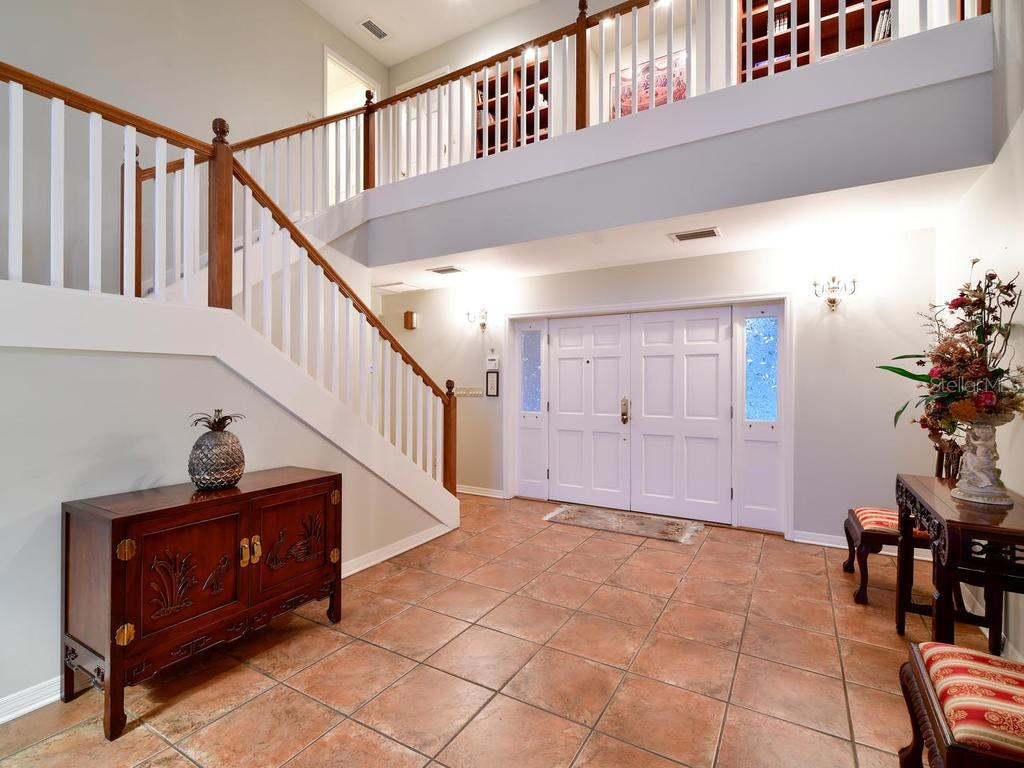 Double door entry into bright and airy Foyer - Single Family Home for sale at 2008 72nd St Nw, Bradenton, FL 34209 - MLS Number is A4450238