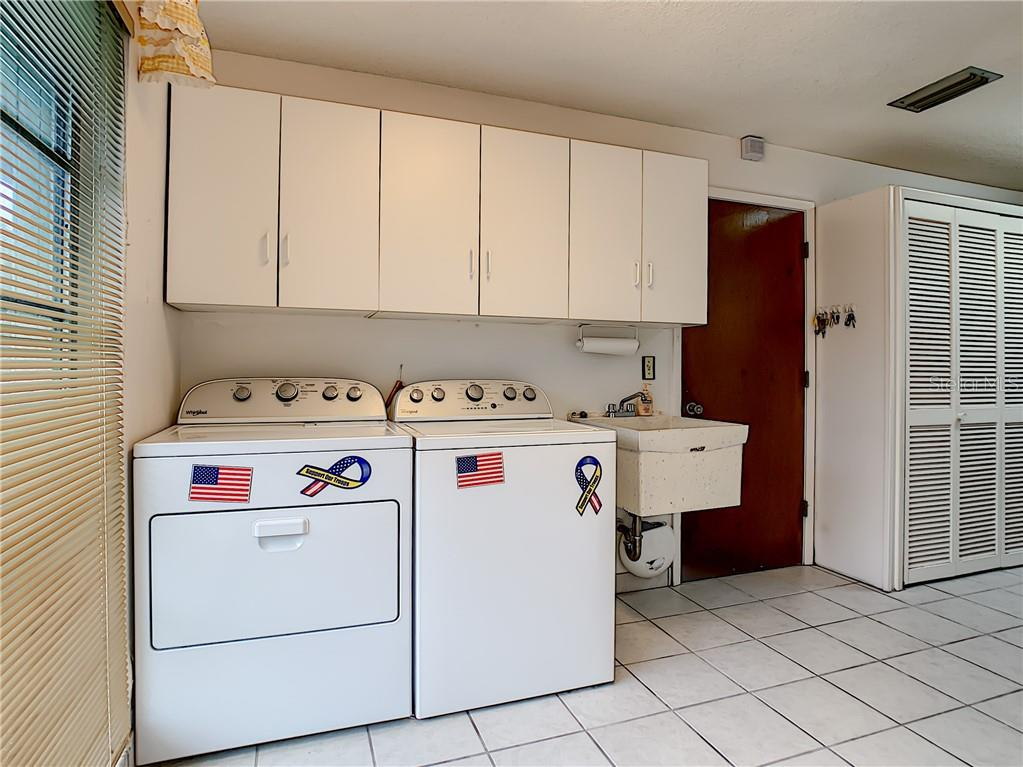 Washer new in 2016, Dryer new in 2018.  Garage door just beyond. - Single Family Home for sale at 7006 18th Ave W, Bradenton, FL 34209 - MLS Number is A4450658