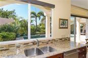 Tranquil views from the kitchen - Single Family Home for sale at 1179 Morningside Pl, Sarasota, FL 34236 - MLS Number is A4209174
