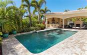 Swimming pool, paver brick lanai, outdoor kitchen and fireplace - Single Family Home for sale at 1179 Morningside Pl, Sarasota, FL 34236 - MLS Number is A4209174