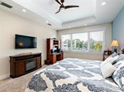 First Floor master bedroom.  Views of the water. - Single Family Home for sale at 7643 Cove Ter, Sarasota, FL 34231 - MLS Number is A4403215
