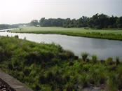 View of #10 hole and waterway. - Condo for sale at 9453 Discovery Ter #201c, Bradenton, FL 34212 - MLS Number is A4423314