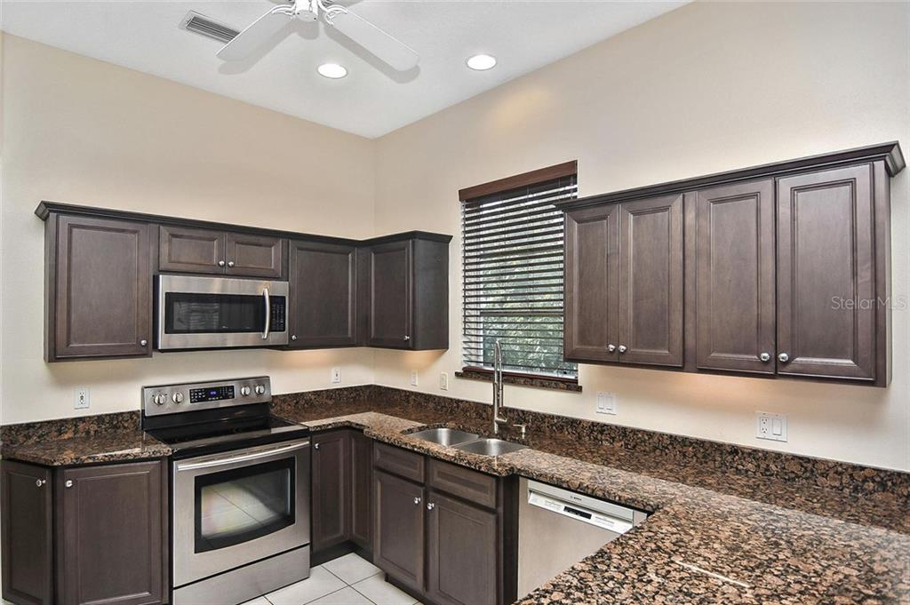 Kitchen - Single Family Home for sale at 724 Silk Oak Dr, Venice, FL 34293 - MLS Number is N6102801