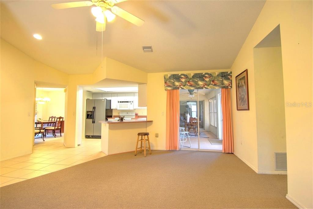 Family Room - Single Family Home for sale at 4884 Jacaranda Heights Dr, Venice, FL 34293 - MLS Number is N6105548